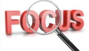 magnifying glass highlighting word focus