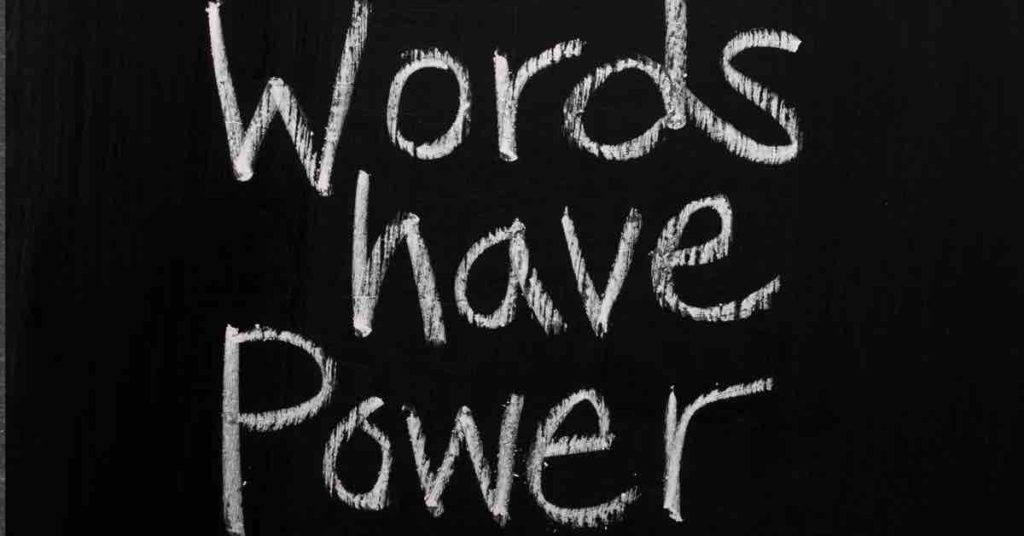 blackboard with writing: words have power