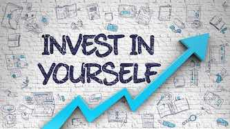 writing: invest in yourself above an arrow that points up