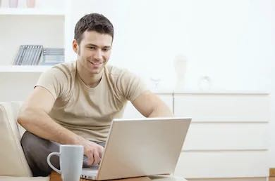 happy man is working on his laptop