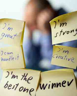 labels with writings: I AM STRONG, I AM THE BEST ONE, WINNER