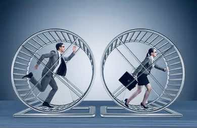 a man and a woman are running in the hamster wheel
