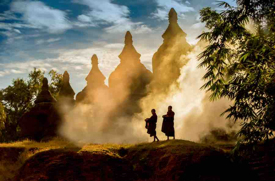 2 monks are walking in the nature