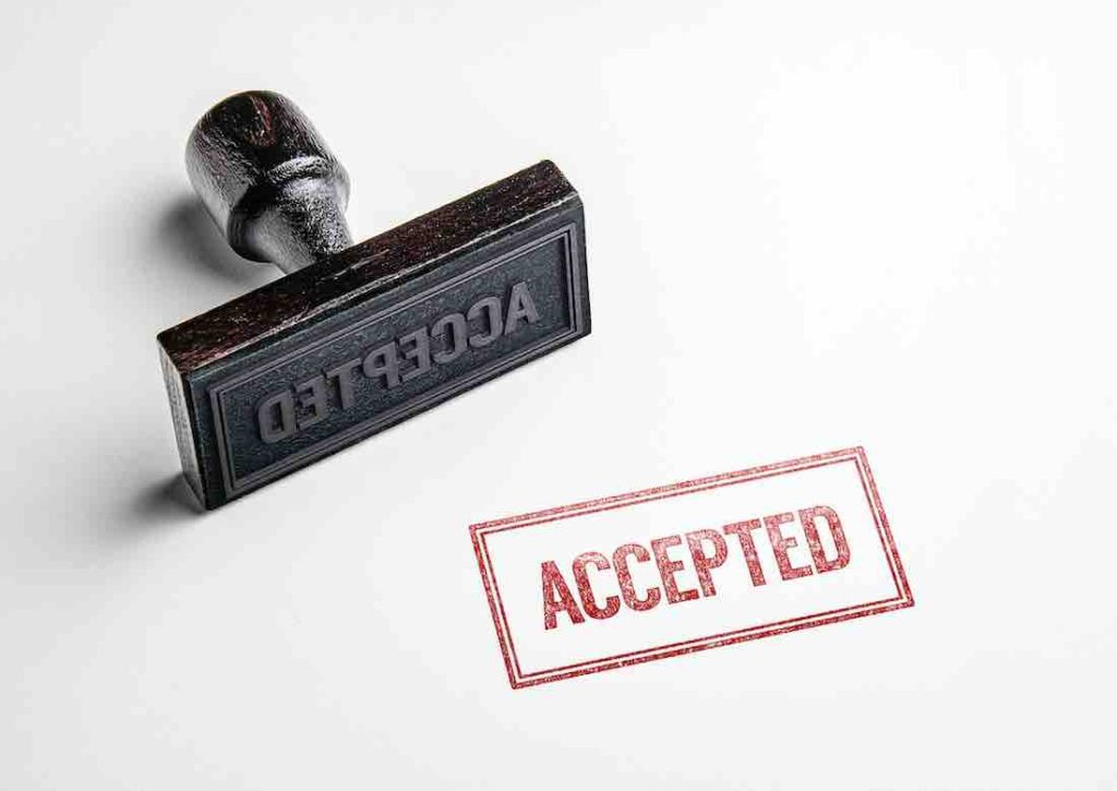 rubber stamp with writing: accepted