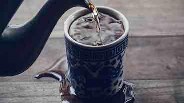 overflowing cup of tea
