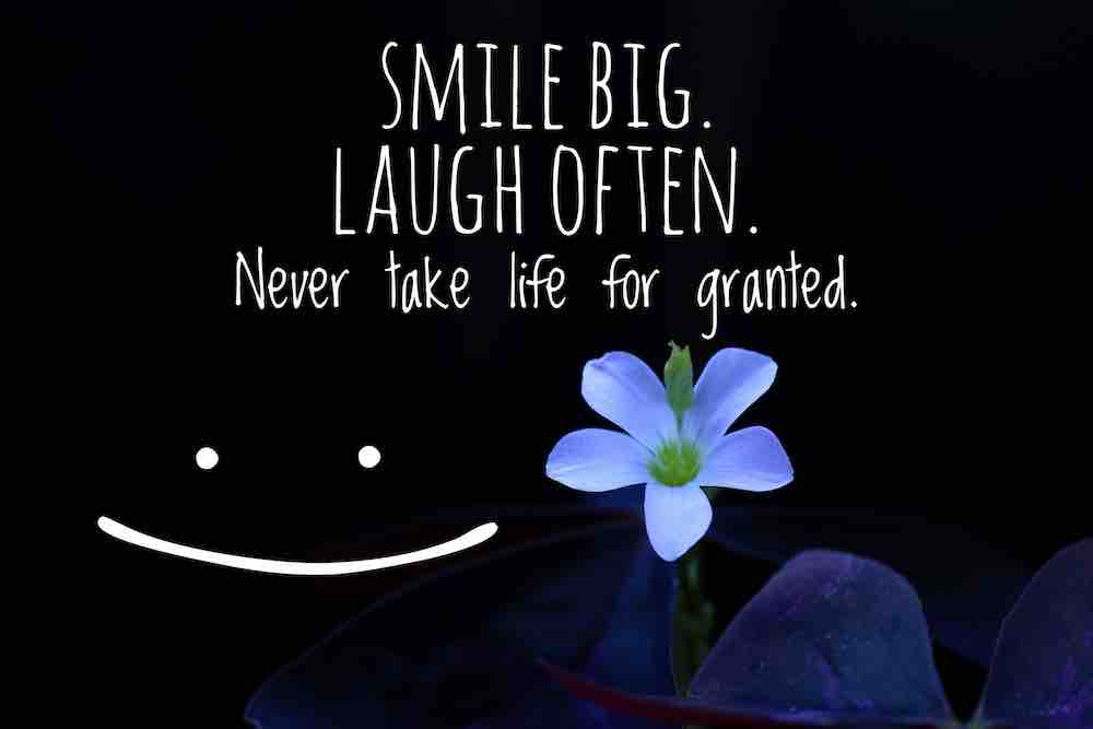 smiley face with writing:smile big, never take life for granted