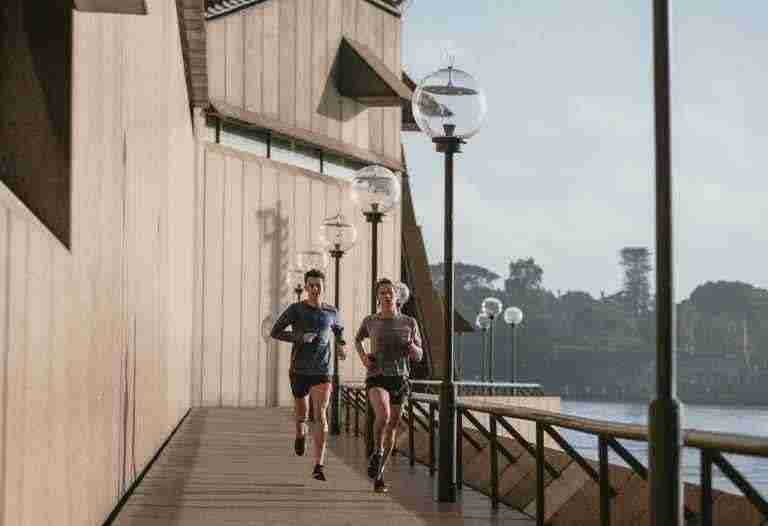 man and woman are running
