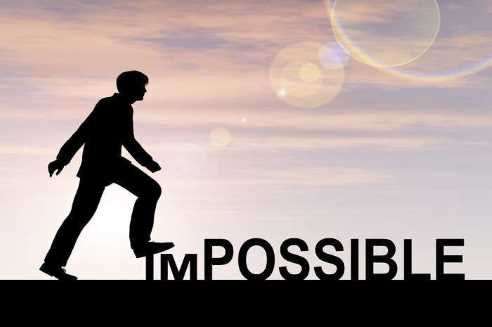Man crushing letter I M of the word IMPOSSIBLE
