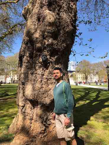 me standing by a tree in one park in Bristol