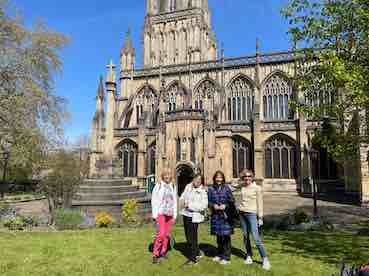 my mum and her friends standing at the entrance of st Mary redcliffe bristol