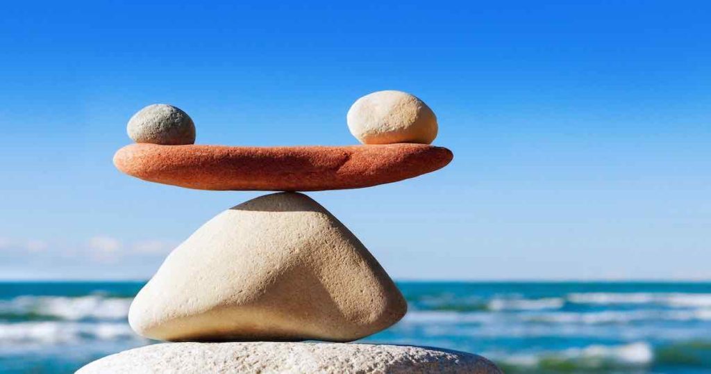 Concept of harmony and balance. Balance stones against the sea