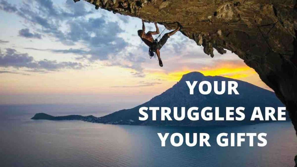 man climbing a mountain with writing: YOUR STRUGGLES ARE YOUR GIFTS