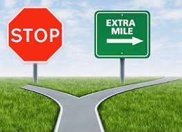 road sign with inscrption: extra mile