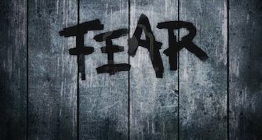 The writing FEAR on the wall