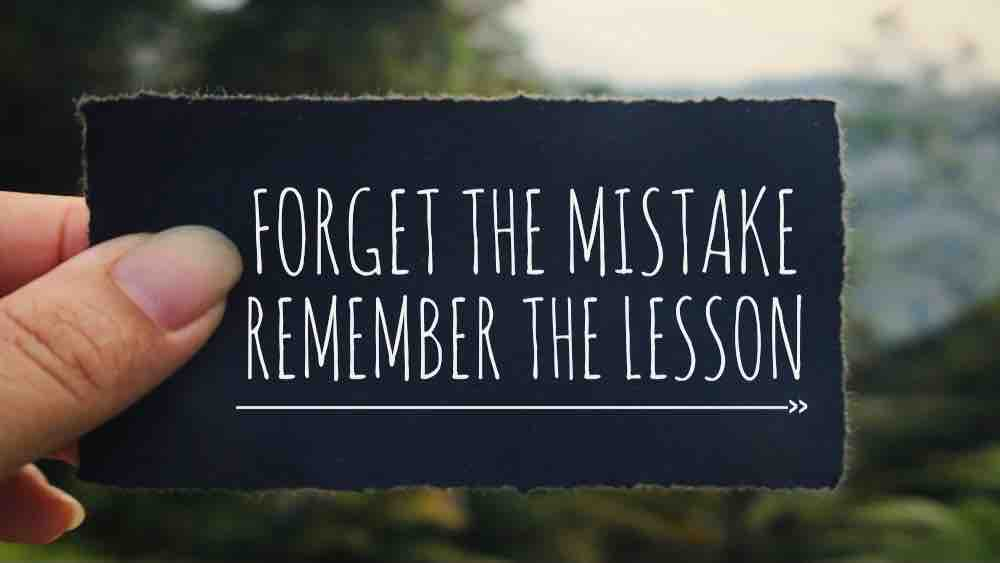 label with inscription: forget the mistake remember the lesson