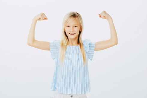 young girl showing her biceps