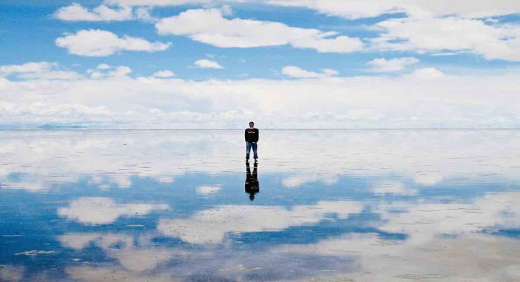 man reflected in the water