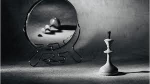 chess pawn reflecting in the mirror