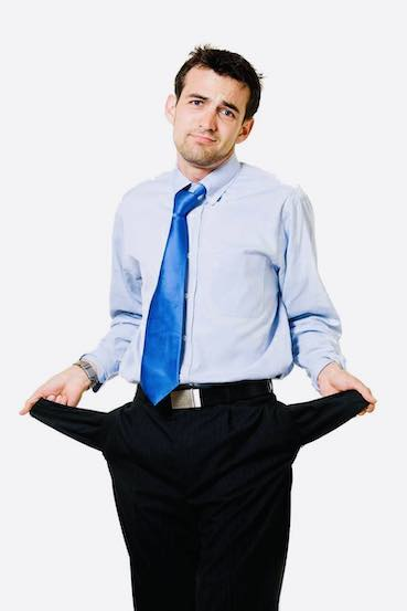 man pulling out his pockets to show he has no money