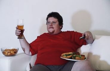 obese man on the couch